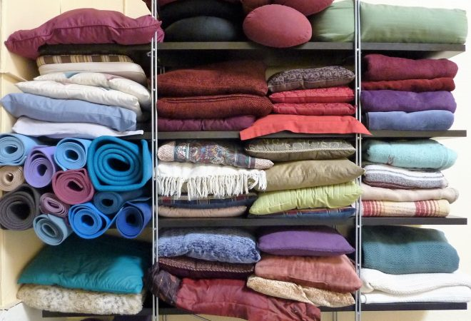 Image of Pillows, blankets, and Yoga mats stored on shelves