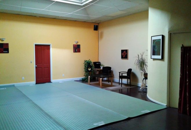 Image of the Studio space with floor mats on wood floors